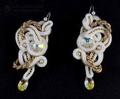 I have performed earrings in white and gold colors with Swarovski crystals, glass beads, small beads. Soutache coils interwoven layers to form an openwork pattern. Earrings were impregnated both sides are lined with eco-beige leather with minimal, so as to ensure transparency form. Hooks are non-allergenic. Length of about 8.5 cm, width about 3.5 cm.  AVAILABLE, email me.  I recommend!