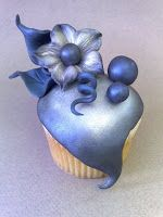 Whimsical Midnight Bloom Cupcake