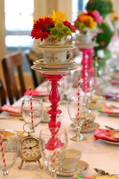 I love this the pink candle holders can be bought at dollar tree spray painted pink and hot glue gunned together. Search around garage sales and swap meets to find vintage tea cups! For cheap