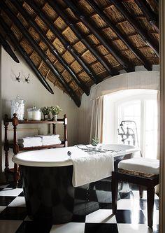 John Jacob bathroom--black and white checkerboard tile, soaker tub, eaves