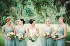 Green bridesmaids dresses look beautiful against a forest backdrop. #HiltonHead #wedding