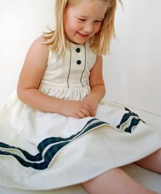 little girl Pearl: The Traditionalist adding piping to a dress... must do to create the 60's look