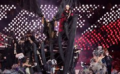 British singer Annie Lennox performs 'Little Bird' aboard a giant wooden gallion during the Closing Ceremony
