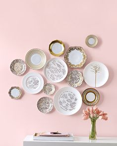 Plates on a pink wall.
