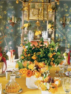 Holiday tablescape by Charlotte Moss. interior design, charlott moss, thanksgiving table, floral arrangements, veranda, christmas brunch, holiday decorating, flower, holiday tables
