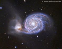 Wow! One of the most stunning and detailed astrophotos we've ever posted! The Whirlpool Galaxy by John Chumack