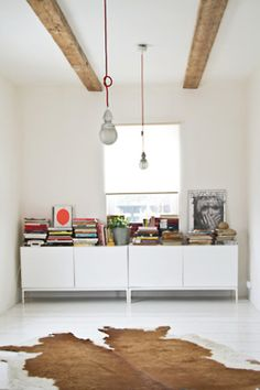 white, beams, hide, pendants, haphazard assortment of books and art