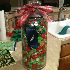 A cool gift idea! You put different gifts inside a glass vase with a lid and then fill it up with candy!