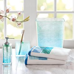 This seaglass bath accessory set from Madison Park adds blue and green accents to create a calming effect in your bathroom area. The lotion dispenser, wastebasket, and toothbrush holder are made of durable resin, and the towels are 100 percent cotton.