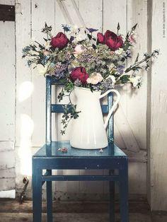 SOCKERÄRT - A white enamelware pitcher makes a beautiful vase for a rustic floral arrangement.