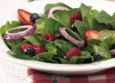 Tri-Berry Spinach Salad  Dressing  1/4  cup oil  1  tablespoon sugar  3  tablespoons frozen raspberry-lemonade concentrate  2  tablespoons vinegar  1/4  teaspoon Dijon mustard  Salad  1  (6-oz.) pkg. prewashed fresh baby spinach (about 7 cups)  1/3  cup sliced fresh strawberries  1/3  cup fresh blueberries  1/3  cup fresh raspberries  1/4  cup sliced red onion, separated into rings