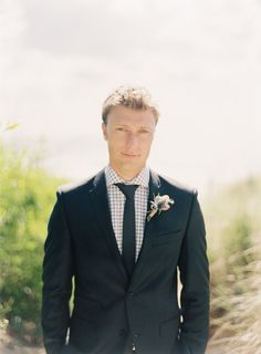the groom | Photo: Byron Loves Fawn, Groom's Attire: Peter Jackson, Floral Designer: Cotton Blossom