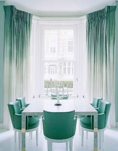 teal dining room with ombre curtains