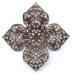 59050  Vintage Four Point Filigree  With such ornate details, its hard to imagine this piece would need any extra embellishment.  However, with all of the cut-outs on each of the four point petals, it is a breeze to customize into an opulent focal.  As with all of our vintage brass, it is lead-free and crafted in the USA.