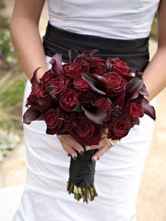 Black magic roses and deep purple calla lilies.