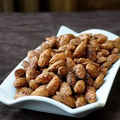 Spicy Smoked Roasted Almonds - a great holiday snacking treat that's a little bit sweet, a little bit salty, a little bit smoky and a little bit spicy. Perfect for serving around the Holidays.