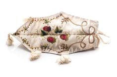 Silk tobacco pouch, early 19th century, three-sided with unique embroidery on each. Charleston Museum