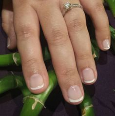 Gel polish french manicure. Guaranteed to last through the wedding and honeymoon.  www.aroyalpampering.com