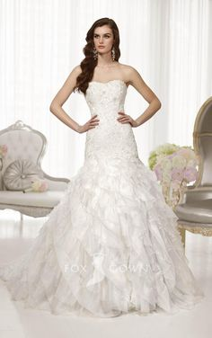 fit and flare ruffled skirt strapless lace applique bodice drop waist wedding dress