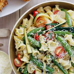 Fresh cherry tomatoes, snap peas, and zucchini are briefly cooked in garlic and then tossed into this pasta salad recipe, creating the perfect side dish to grilled meat.