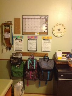 I took this from a friend of mine.  Each kid has a spot with a dry-erase board with to-do's, backpacks, and lunchboxes.  Family calendar above.  Great idea!