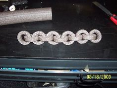 Easy chain from pipe insulation Would be good to use for our drawbridge.