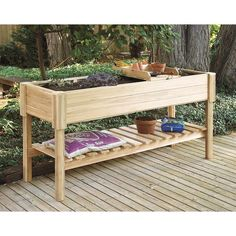 Raised garden center - add a storage shelf underneath when building it yourself