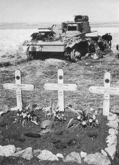A wrecked Pz.Kpfw. III tank and the graves of its three crew somewhere along the front of Army Group South in August 1941. Note the steel helmet split open and one projectile of the tank's gun deposited on the graves.