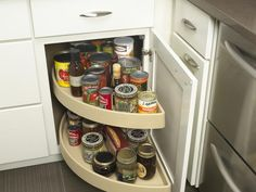 Maximize kitchen cabinet space with a Lazy Susan.