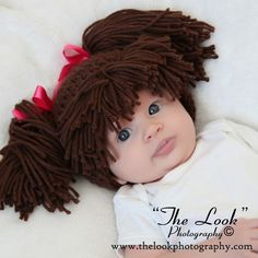Cabbage Patch Doll hat.  So funny!  Might be a great Halloween costume next year.