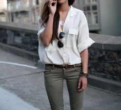Loose fitting silk blouse paired with skinny trousers