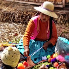 Indigenous woman from Lake Titicaca making Pom poms