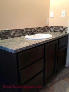 My $200 bathroom vanity DIY makeover... I painted the formica counter top to look like granite!  Martha Stewart....In Black.