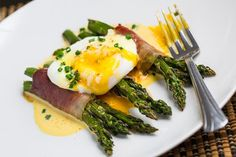 Roast asparagus bundles wrapped in crispy and salty prosciutto topped with a poached egg and lemony and buttery hollandaise sauce.