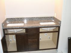 Azul Platino granite countertop with dark cabinets... Probably will do this in master instead...