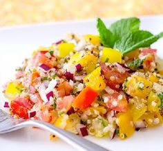 """Colorful Tomato & Quinoa Salad: """"If you can't find orange or yellow tomatoes, use red tomatoes or other vegetables in different colors.""""  —InnerHarmonyNutrition"""
