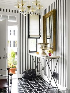 Block Print Stripe wallpaper by Farrow & Ball. Design: Hillary Thomas and Jeff Lincoln. Photo: Eric Piasecki. housebeautiful.com. #entry #foyer #wallpaper #black_and_white #stripes