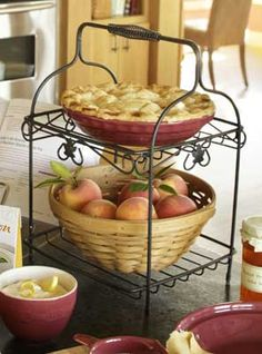 """Click to view Longaberger's Wrought Iron Two-Tiered Server! Our beautiful Wrought Iron 2-Tiered Server anchors your countertop in style with delicate accents, smooth welds and an antique-style spring handle. It's the perfect addition to any kitchen for everyday décor or an elegant presentation. The options are limitless for the Longaberger plates and baskets it can hold! It's extremely versatile and looks fantastic on any table top. 11""""l x 11 1/2""""w x 16 1/2""""h"""