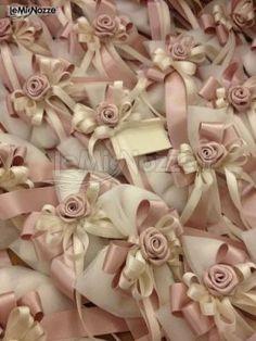 Sacchetti porta confetti con fiocco rosa