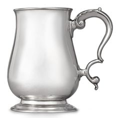 An American Silver Cann, Paul Revere Jr., Boston, circa 1775 of plain baluster form on molded spreading foot, with leaf-capped double-scroll handle marked on base REVERE in rectangle (Kane mark B) height 5 1/8 in.