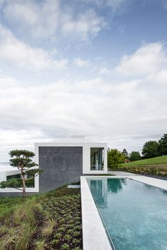 House and swimming pool Identical Houses Built on the Hill by Think Architecture