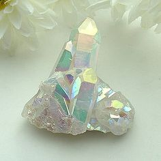 "Angel Aura Quartz Point Cluster ~ ""Stone of attunement to beauty"" See metaphysical & healing properties here: http://www.shimmerlings.com/gemstones/aqua_aura.htm"