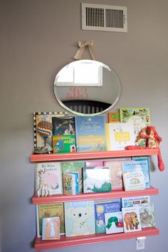Love these DIY'd pink bookshelves for this library wall in the nursery! #nursery #DIY