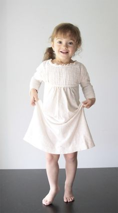 it only takes 10 minutes to turn a women's tee into an adorable little girl's #nightgown with this super easy #sewing tutorial. step-by-step photos included!