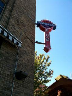 pub sign, brick, river market