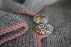 How-To Make a Yarn Button Loop Using the Button Hole Stitch. Video tutorial. This is shown on a knitted piece but I think it would look great on any crochet item too that needs a button.