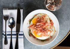 A combination of soft beans, harissa-imbued vegetables, crisp-edged fried eggs and salty bits of cured tuna (or prosciutto), this unusual brunch dish is substantial and interesting enough to serve for dinner.