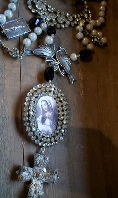 rosary made of jewels and pins. Great way to use family heirloom costume jewelry.