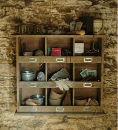a wall unit with nine cubbies for potting shed or tool bench via Gardenista
