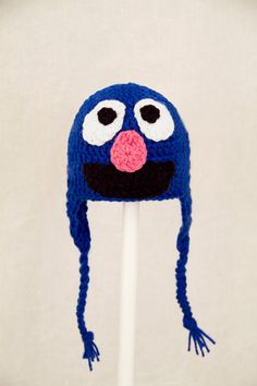 How fun is this!!  Grover Monster Earflap Hat from Sesame Street Blue by GeekinOut, $30.00 - NO Pattern